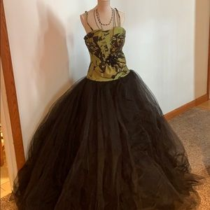 Green and black gown by flirt maggie sottero